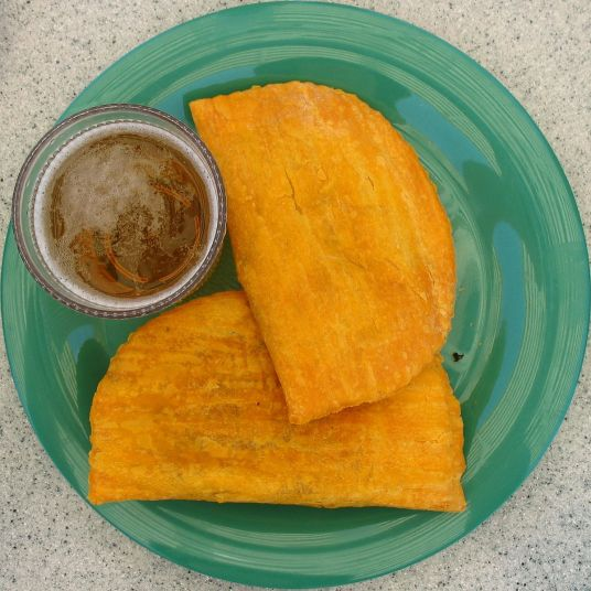 1200px-Jamaican_patties_and_redstripe